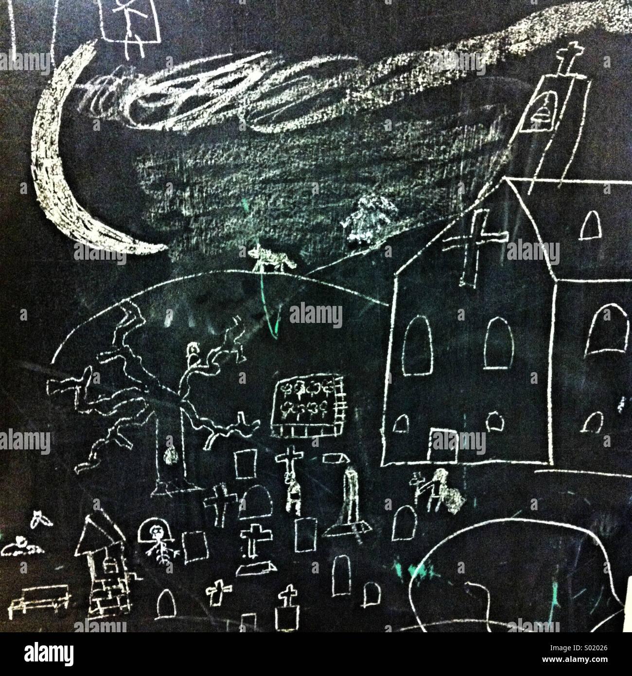 desenho de uma criança de uma igreja e um cemitério em um chalk