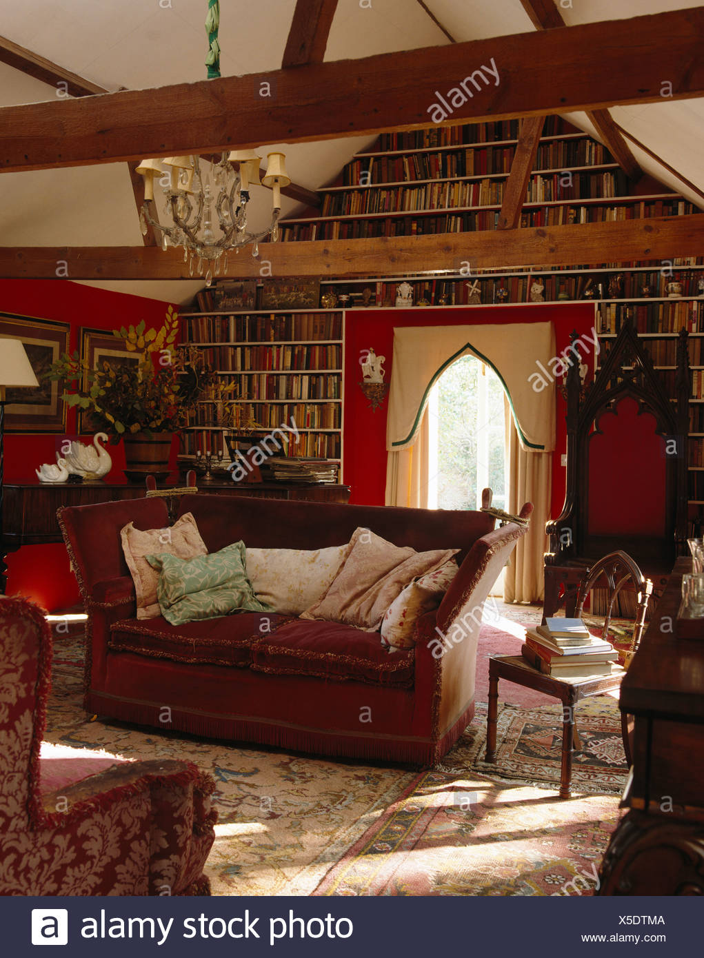 Knole sofa and Gothic throne chair in country living room with wall ...