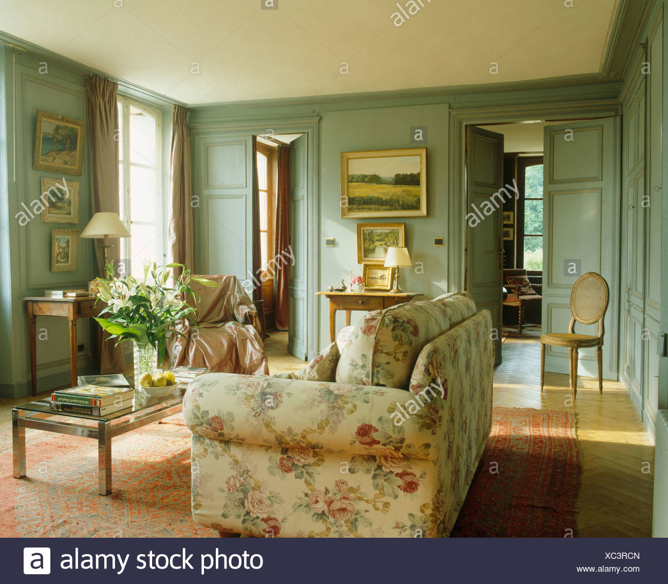 Floral sofa in French country living room with gray-green ...
