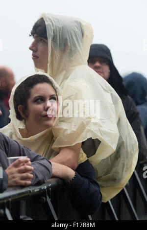 Portsmouth, UK. 29th August 2015. Victorious Festival - Saturday. Dressed for festival weather - a couple in matching - Stock Image