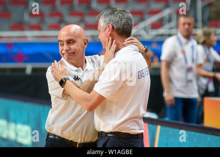 Riga, Latvia. 1st of July, 2019. Chema Buceta (L), after Great Britain's Women's basketball team  win against Montenegro, during qualification match to 1/4 final at  FIBA Women's Eurobasket 2019 in Riga , Latvia. Credit: Gints Ivuskans/Alamy Live News - Stock Image