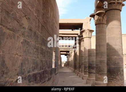 A photograph taken of Philae, an island in the reservoir of the Aswan Low Dam, Egypt. Philae was initially located near the expansive First Cataract of the Nile in Upper Egypt and was the site of an Egyptian temple complex. The temple complex was dismantled and moved to nearby Agilkia Island as part of the UNESCO Nubia Campaign project, protecting this and other compounds before the 1970 completion of the Aswan High Dam. The most ancient was a temple for Isis, built in the reign of Nectanebo I during 380-362 BC, the other ruins date from the Ptolemaic Kingdom (282-145 BC), with many traces of - Stock Image