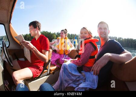 Family boat trip, Swedish archipelago. - Stock Image