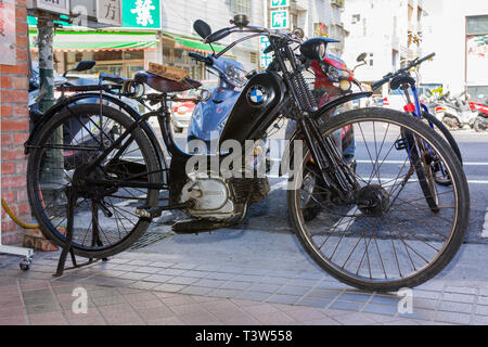 Black bicycle with Honda engine, motorized bike with BMW logo, Taiwan - Stock Image