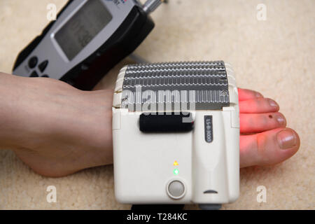 Cold laser LED array pad treatment for foot therapy and healing - Stock Image