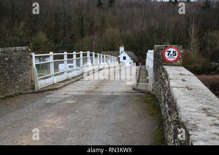 Whitney-on-Wye toll bridge, crossing the River Wye and linking Herefordshire, England and Powys, Wales. - Stock Image