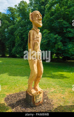A chain saw wooden sculpture of the BFG Big Friendly Giant in the grounds of the Bowes Museum accompanying an exhibition of drawings of the character - Stock Image