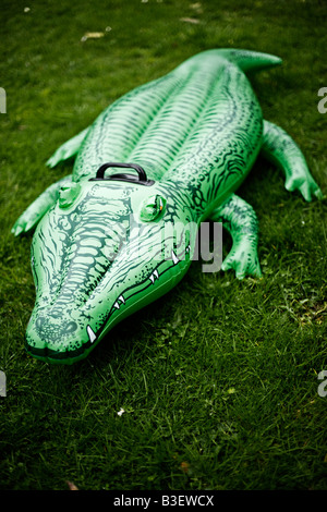 Inflatable crocodile series Suburban menace - Stock Image