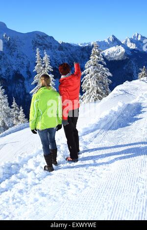 Two women in snow, Tegelberg, Ammergau Alps, Allgaeu, Bavaria, Germany, Europe - Stock Image
