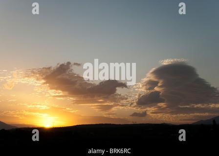 Sunrise and lenticular clouds Crete Greece - Stock Image