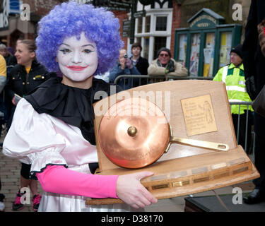 Andrea Mulchrome with the Frying Pan Trophy for winning the Womens Pancake Race which is part of the traditional - Stock Image