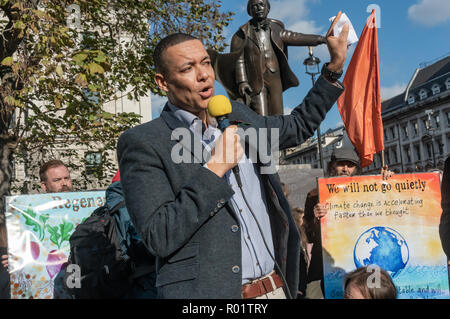 London, UK. 31st October 2018.  Labour MP Clive Lewis speaks at the Extinction Rebellion protest in Parliament Square.  Other speakers included Swedish schoolgirl Greta Thunberg, campaigner Donnachadh McCarthy, and economist and Green MEP Molly Scott Cato before the protesters made a 'Declaration of Rebellion' against the British Government for its criminal inaction in the face of climate change catastrophe and ecological collapse. Credit: Peter Marshall/Alamy Live News - Stock Image
