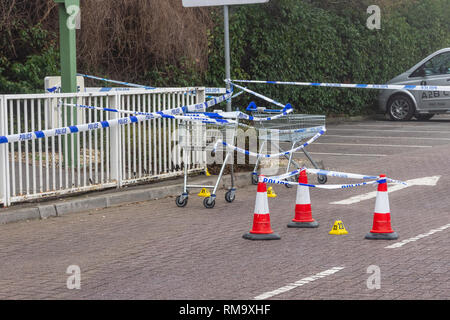 Trowbridge, Wiltshire, UK. 14th February 2019. Overnight there was a double stabbing near the Tesco Extra store. One victim rumoured to be critical. Details of trollys cones and crime scene markers around an area of special interest Credit: Starsphinx/Alamy Live News - Stock Image