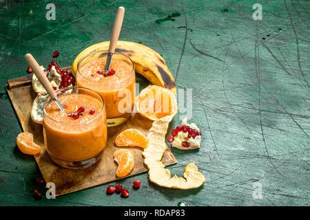 Fresh fruit smoothie. On rustic background - Stock Image