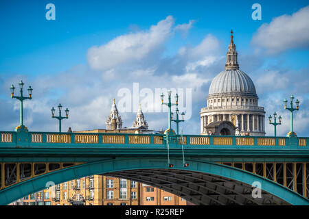 View of the iconic St. Paul's Cathedral over Southwark Bridge, London, UK - Stock Image