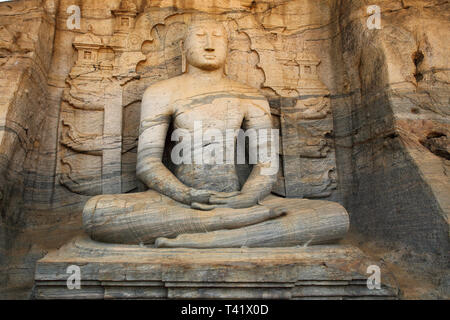 gal vihara shrine with four buddha statues carved from a single piece of rock at the polonnarawa archaeology site in the cultural triangle of sri lank - Stock Image