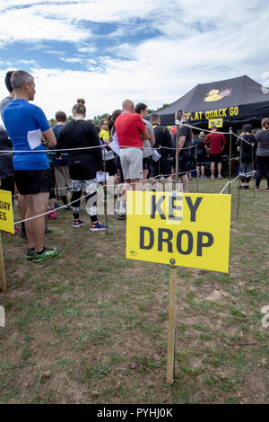 At an obstacle course race a key drop so you don't lose them in the mud - Stock Image