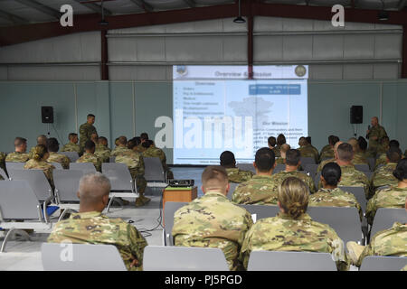 Lt. Col. Andrew Frankel (left), Deputy Air Reserve Component advisor and Col. Cory Reid (right), Senior ARC advisor, speak to Air Reserve and Air National Guard members deployed to the 407th Air Expeditionary Group at a town hall meeting at an undisclosed location in Southwest Asia, Aug. 24, 2018. Frankel and Reid met with ARC Airmen and 407th AEG leadership at all levels to make sure they had a complete understanding of what ARC Airmen bring to the fight and address any concerns ARC members may have while deployed. (U.S. Air Force photo by Staff Sgt. Dana J. Cable) - Stock Image