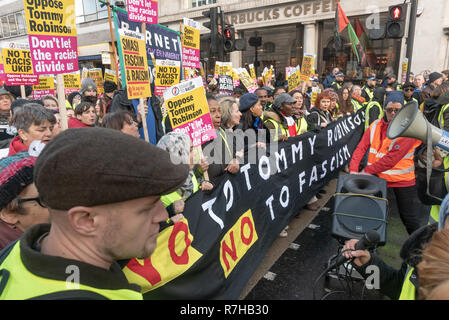 London, UK. 9th Dec, 2018. Women hold the main banner 'No to Tommy Robinson No to Fascism' at the start of the united counter demonstration by anti-fascists in opposition to Tommy Robinson's fascist pro-Brexit march. The march which included both remain and leave supporting anti-fascists gathered at the BBC to to to a rally at Downing St. Police had issued conditions on both events designed to keep the two groups well apart. Credit: Peter Marshall/Alamy Live News - Stock Image