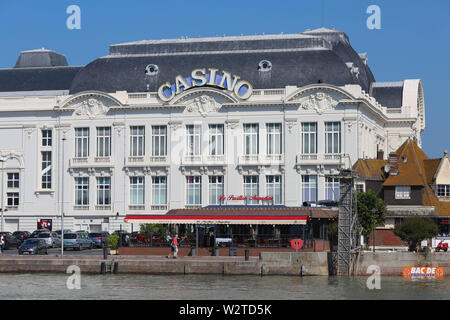 General view of the Casino de Trouville, in the foreground, part of the marina. - Stock Image