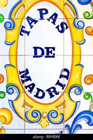 Madrid Tapas de Madrid sign on glazed ceramic tiles on traditional tapas bar on Madrid Gran Via. - Stock Image