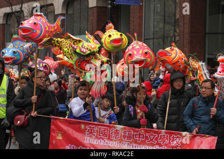 London, UK. 10th February 2019.  Hundreds of Londoners attend the Chinese New Year Celebration in Chinatown, central London to urse in the Year of the Pig. The event was organised by the London Chinatown Chinese Association (LCCA). Photo by David Mbiyu/ Alamy Live News Credit: david mbiyu/Alamy Live News - Stock Image