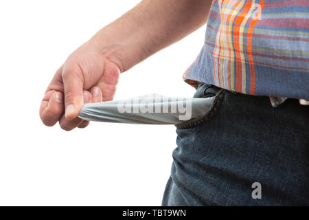 Closeup of empty pants or trousers jeans pocket presented by man as moneyless concept isolated on white background - Stock Image