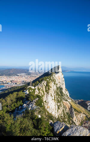 Gibraltar, View of Gibraltar rock, in the distance is the Gibraltar - Spanish border at La Linea - Stock Image