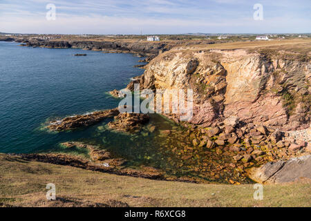 Rugged coastline at Rhoscolyn on Anglesey, North Wales - Stock Image