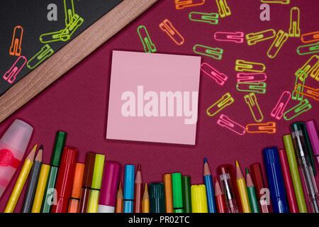 Adhesive notes, blackboard with pencils on colorful background, blank copy space - Stock Image