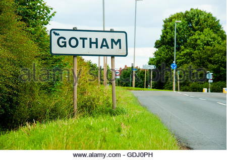 Stock photo of road signs that say Gotham, the small village in Nottinghamshire, which has a Bat sprayed onto it - Stock Image