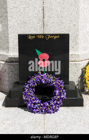 8th May 2017, Bury, Greater Manchester, UK. Two weeks after Anzac Day (April 25th), an Iris flower wreath lies at the foot of Bury war memorial. - Stock Image