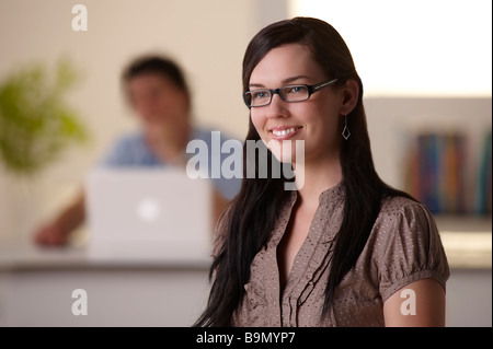 Young woman in office - Stock Image