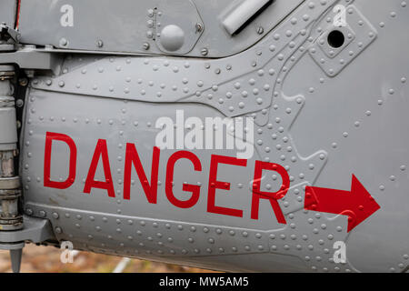 Danger warning on the side of  Westland Lynx HAS3 Serial 259 Register ZD254 formerly of the Fleet Air Arm at the Albert Dock Liverpool May 2018 - Stock Image
