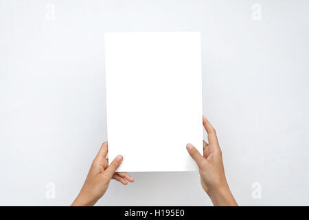 Closeup Blank White Paper Sheet Mockup Holding Female Hands Abstract Grey Background - Stock Image