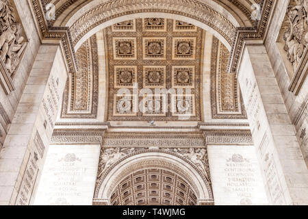 Arched ceiling and details of Arc de Triomphe along Champs Elysee, Paris, France - Stock Image
