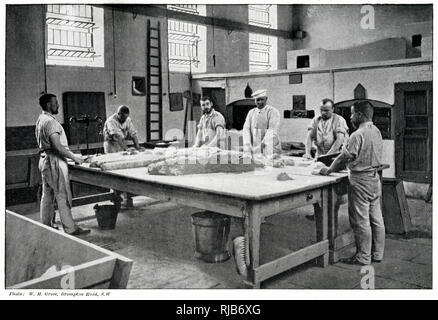 Prisoners working in the bakery. - Stock Image