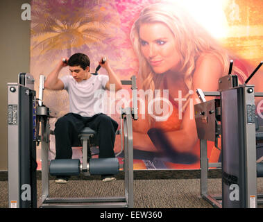 Milford, CT USA-  Craig Rich of West Haven uses a crunch machine at the new LA Fitness at the Westfield Connecticut - Stock Image