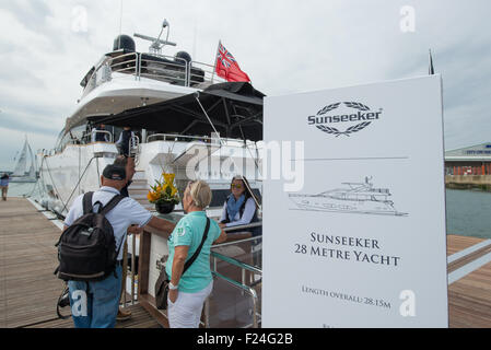 Southampton, UK. 11th September 2015. Southampton Boat Show 2015. Visitors register at a reception desk to view - Stock Image