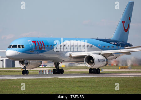 A TUI Airways Boeing 757-200, registration G-OOBC, taking off from Manchester Airport, England. - Stock Image