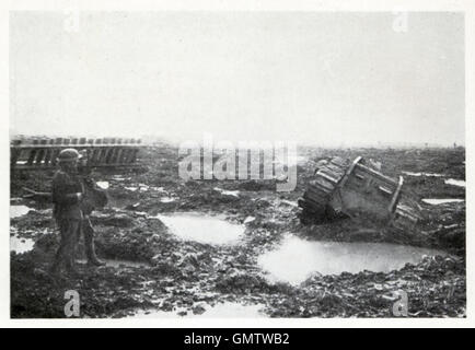 Tank in Shell Hole, 1917 battlefield photograph of a British tank half submerged and bogged down in water on the - Stock Image