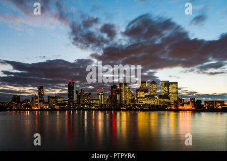 City lights over the River Thames and Canary Wharf, London Docklands, London, UK - Stock Image