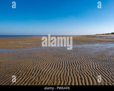 Ripples in the vast sandy beaches of the north Norfolk coast, England, UK - Stock Image
