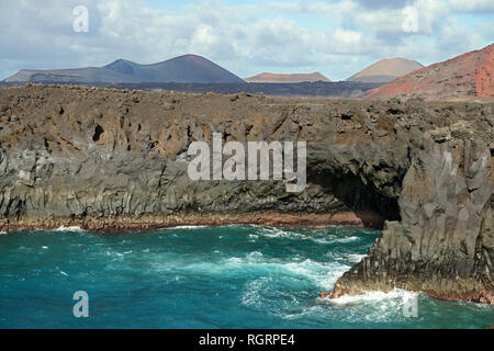 Los Hervideros is a stretch of spectacular volcanic cliffs and underwater caves on the island of Lanzarote located to the north of Playa Blanca - Stock Image