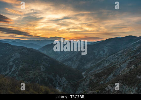 Colorful sunset in the mountain - Stock Image