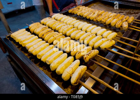 Sausages on a grill, Star Night Bazaar, night market, Rayong, Thailand - Stock Image
