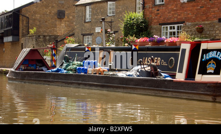 Historic traditional working boat Jubilee with cargo of coal at Stoke Bruerne on the Grand Union Canal Doug Blane - Stock Image