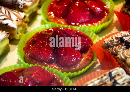 Freshly baked stuffed sweet pastries with red fruits in traditinal French bakery in small village in Provence - Stock Image
