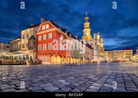 Stary Rynek square with small colorful houses and old Town Hall at dusk in Poznan, Poland - Stock Image