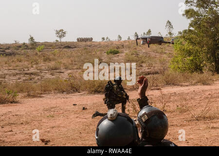 Members of Cameroon's elite Rapid Intervention Battalion (BIR) recover a drone as they prepare to conduct a mock counter-terrorist raid near Bobo-Diou - Stock Image